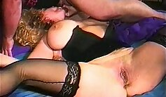 Amazing threesome with busty milf and couple