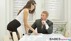 Busty brunette babe flirts with fellow coach in office