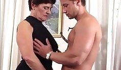 busty granny giving a german blowjob