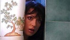 Busty brunette masturbates in her bathroom