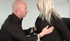 blonde with big tits is sucking two big pecker in the office