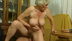 Busty granny with nice tits eaten by young guy in the shower